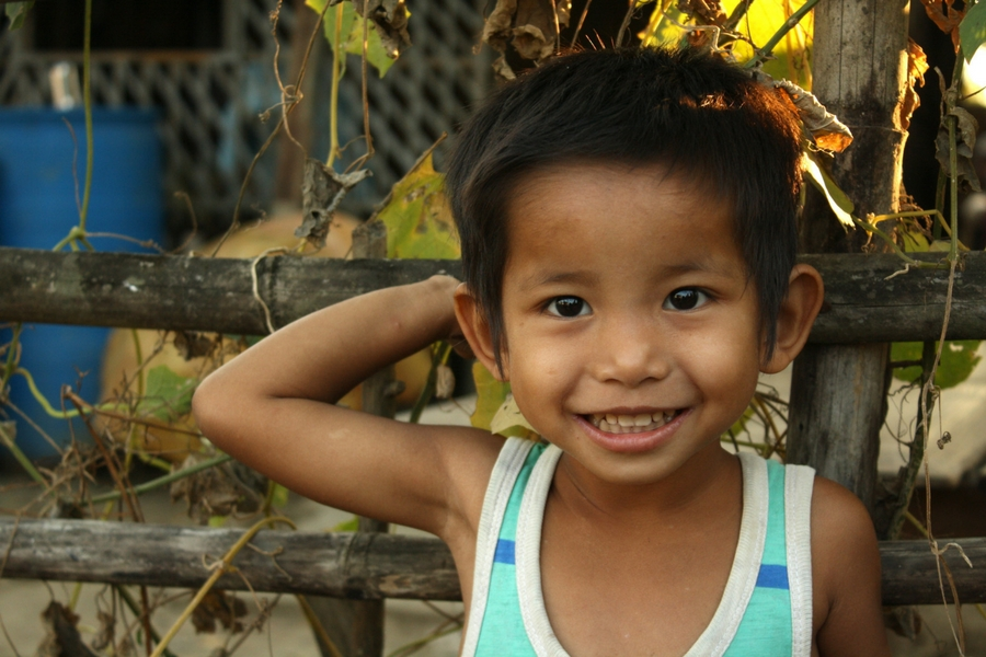 Image of a smiling young boy from village near Yangon Myanmar.