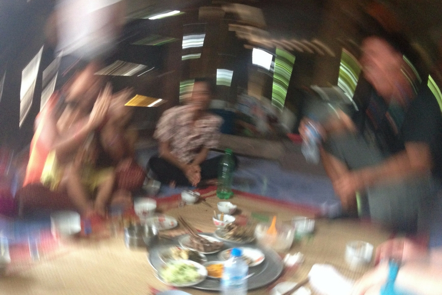 Blurry shot of the volunteers sharing shots with the family in Xom Pung. The blurriness represents how we felt!