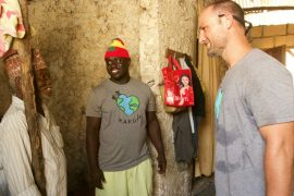 Image of RAKLife founder, Matt Foster, speaking with an elder in Paje Village, Zanzibar.