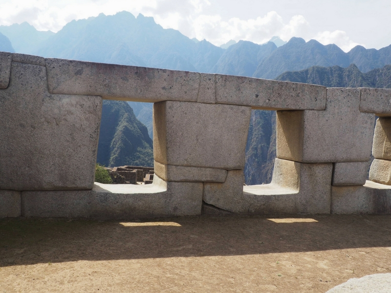 Image of Andes Mountains through the windows of Machu Picchu in Peru.