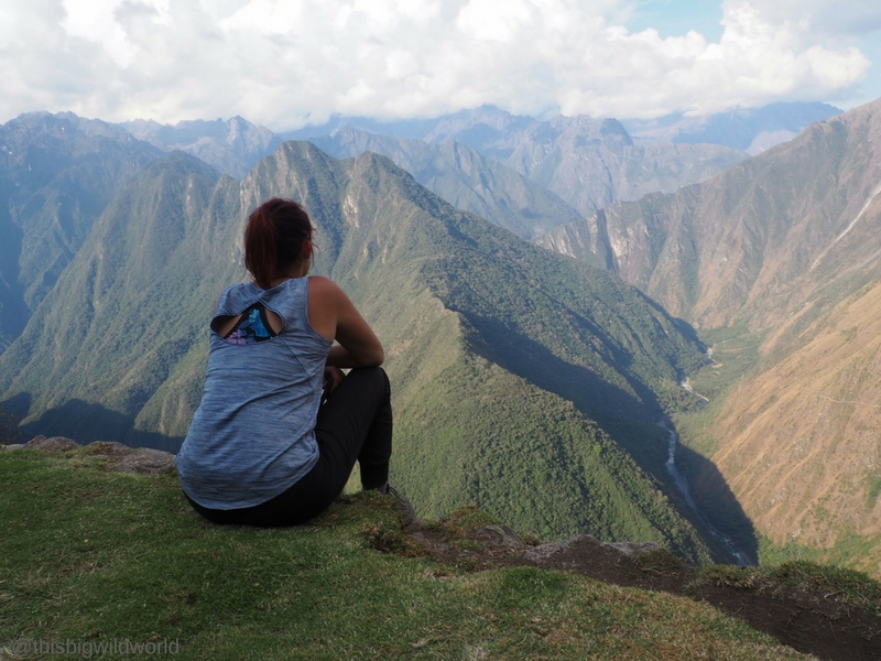 Image of me looking out at the Andes Mountains from the ruins at the end of Day 3 on the Inca Trail hike.