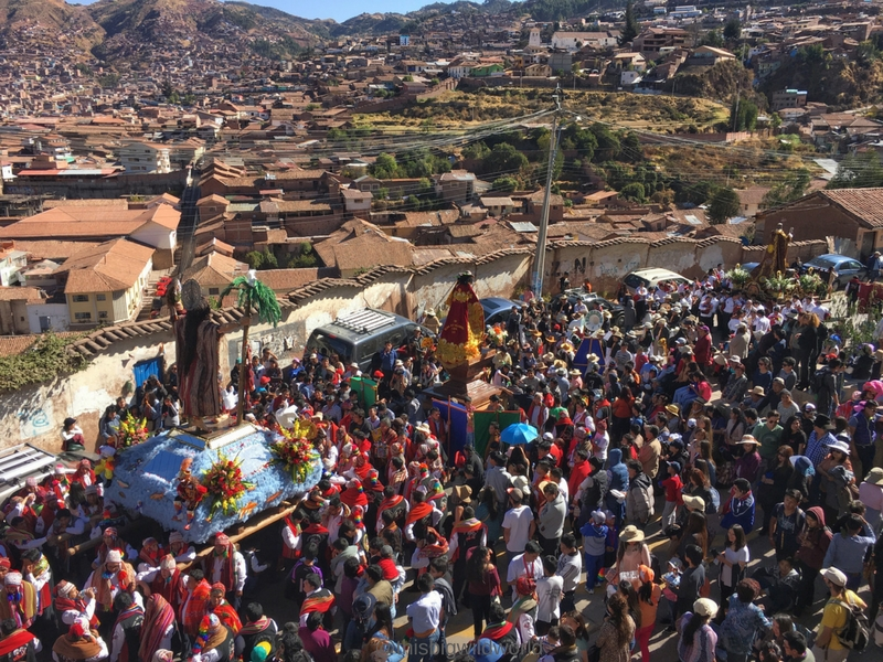 Image of parade carrying statues of saints through the streets of Cusco for the Corpus San Cristobal festival in Cusco Peru.