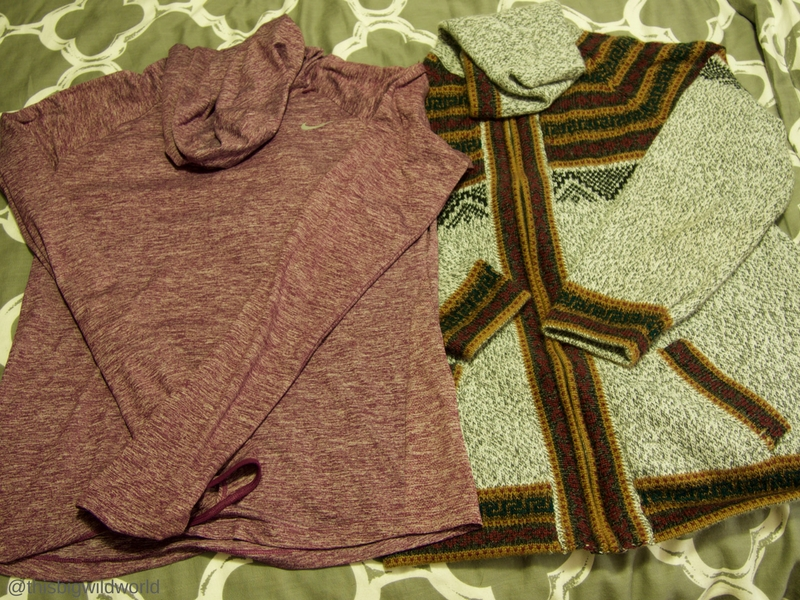 Image of warm clothing packed for the Inca Trail hike in Peru, including a lightweight long sleeve shirt and a sweater.