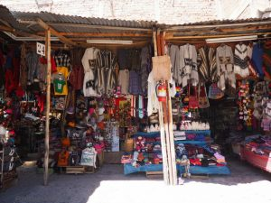Image of souvenir shop down an alley near Plaza de Armas in Cusco Peru.