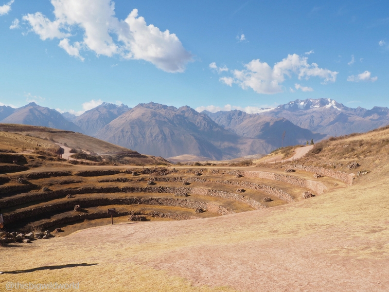 Image of Inca ruins at Moray with mountains in the background in the Sacred Valley near Cusco Peru.