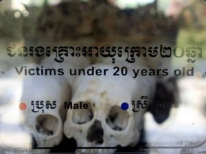 Image of skulls arranged by age and gender on display at the memorial at the Killing Fields in Cambodia.