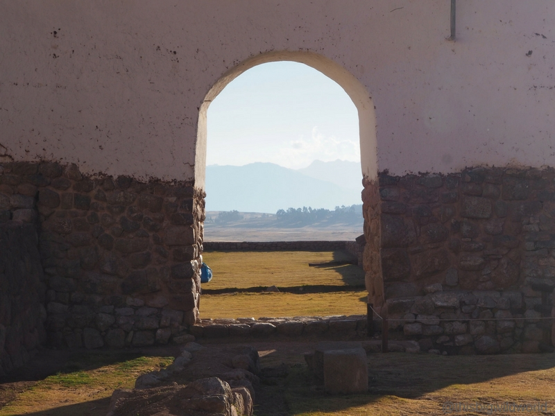 Image of the mountains through a doorway as seen from the church at Chinchero in the Sacred Valley near Cusco Peru.