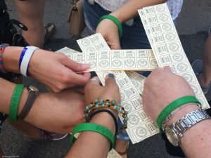 Image of my cousin's matching travel bracelets and drink tickets at a concert in Minneapolis Minnesota.