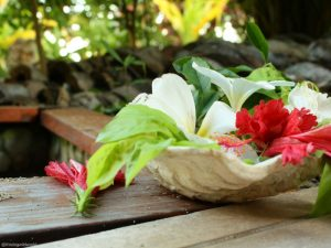 Image of fresh flowers at the footbath in front of my village at Blue Lagoon Beach Resort in Fiji.