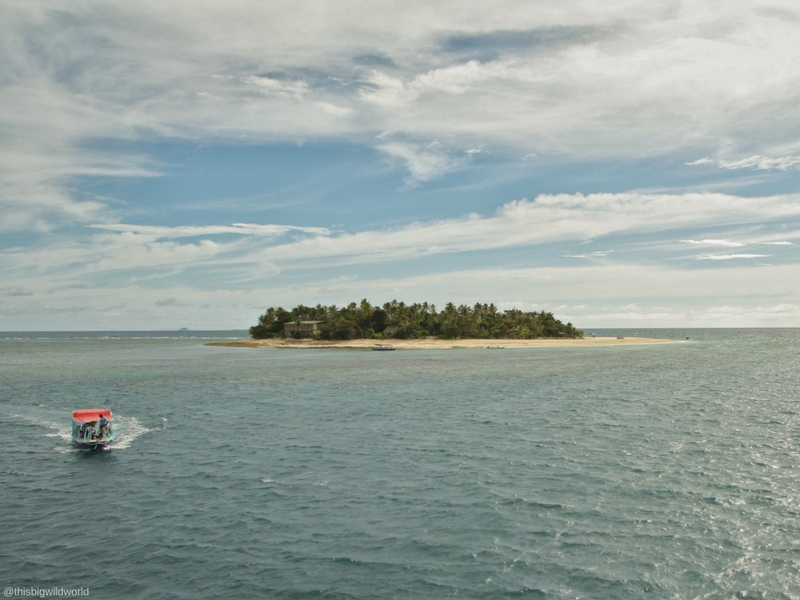 Image from the Yasawa Flyer ferry. A boat is approaching from one of the islands to pick up passengers from the Yasawa Flyer.