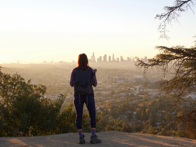 Image of me looking out at downtown LA from the trails at Griffith Observatory at sunrise.