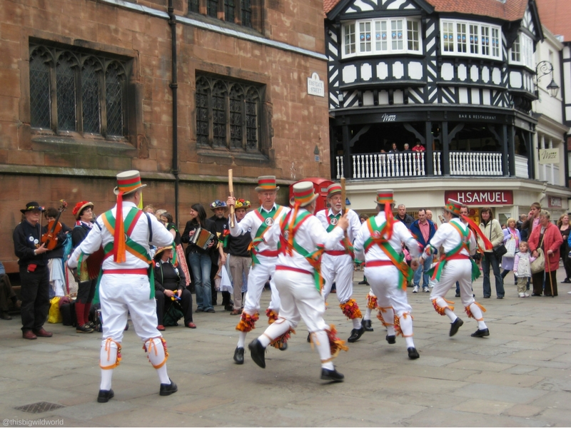 Image of dancers in the city centre of Chester during a St. George's Day celebration in England.