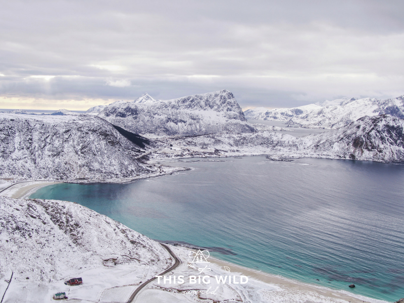 Capture a beautiful view of Haukland Beach from above by hiking Mannen in the Lofoten Islands Norway.