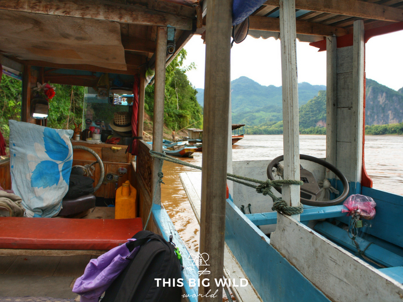 When the long boat captain's friend came to save the day on his own long boat near Luang Prabang in Laos.