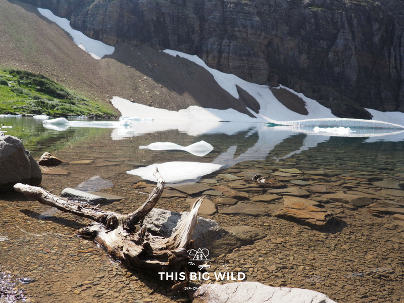 Iceberg Lake offers perfect reflections of the landscape in its glacial water.