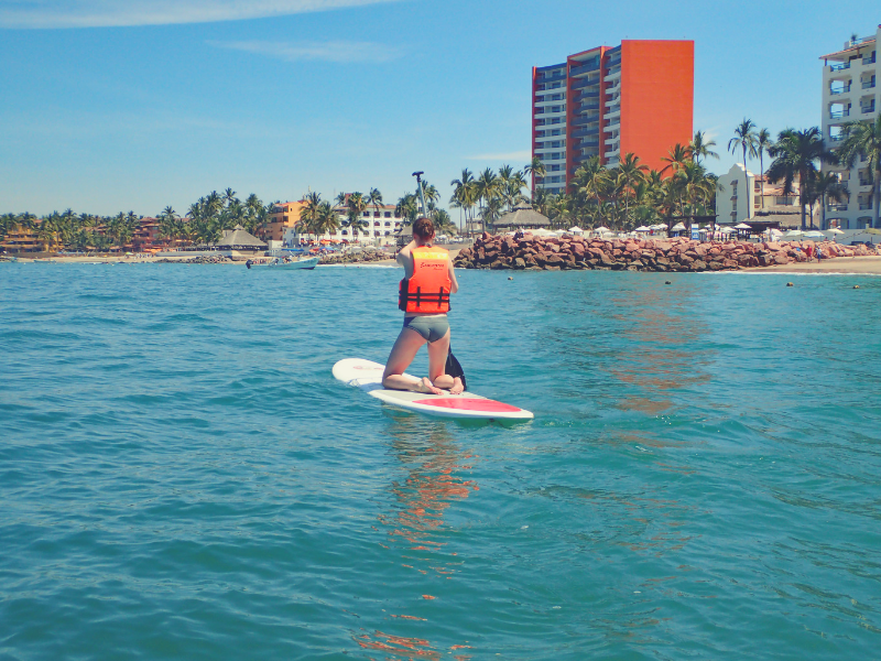 Find your adventure with Flight to Somewhere as she paddleboards in Mexico.