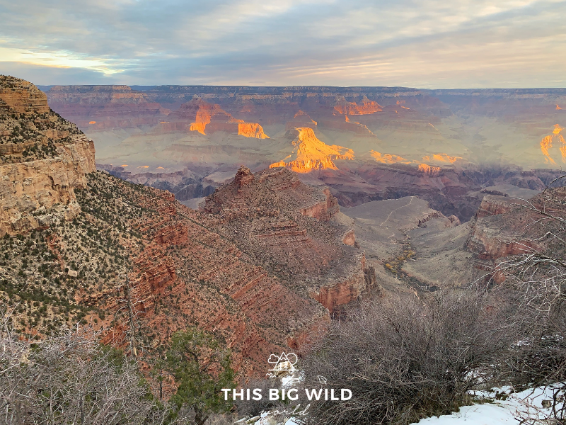 Enjoy the sunrise over the Grand Canyon while on your Arizona road trip.