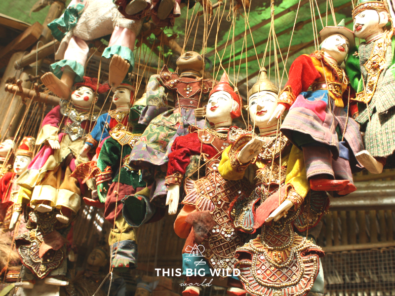 Visit the Bagan Traditional Market to buy local good and foods like these puppets.
