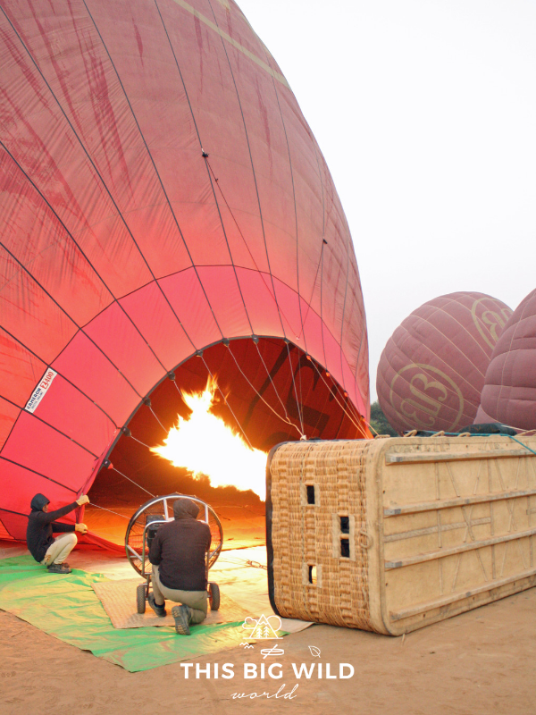 Watch the hot air balloon prepare for takeoff at sunrise in Bagan Myanmar.