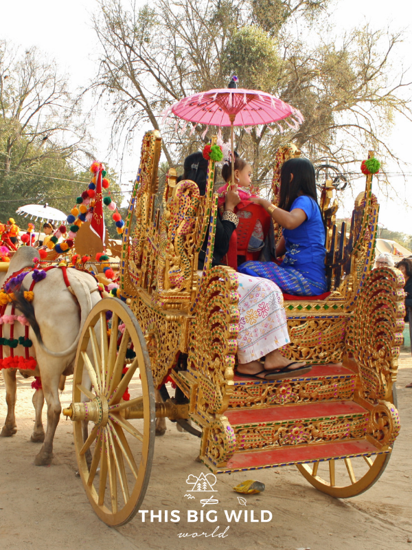A golden carriage for the Shinbyu celebration carries a young boy through the village in Bagan.