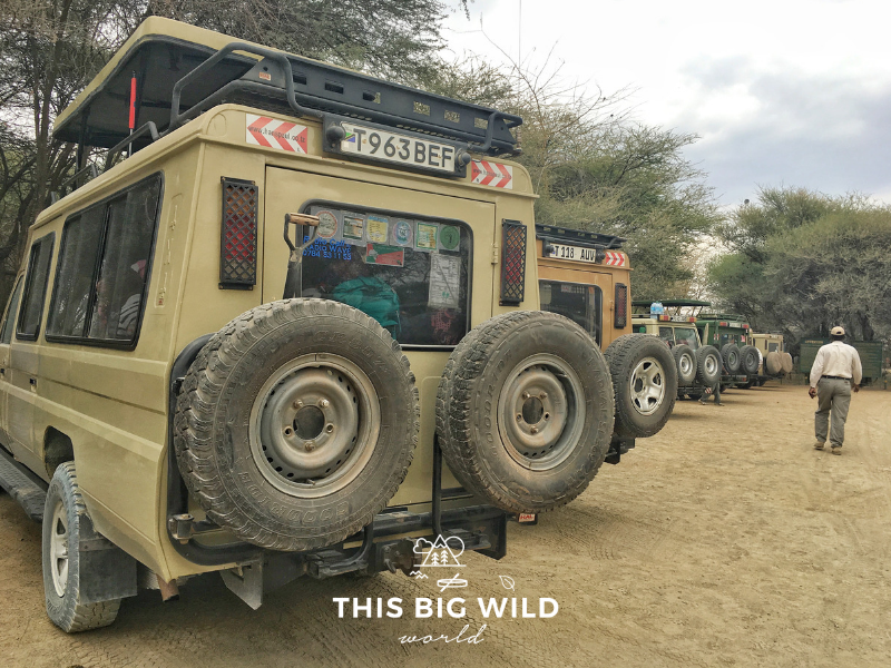 Our Land Rover parked while we wait at the entrance to one of the National Parks in Tanzania on a camping safari.