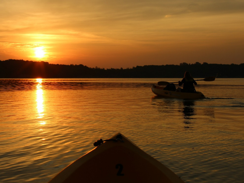 Kayaking at sunset is just one of many activities to enjoy at Deer Creek State Park in Ohio. Photo by Tonya from Travel Inspired Living.