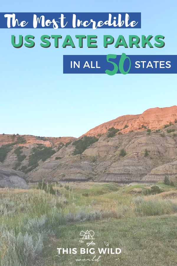 "Text: ""The Most Incredible US State Parks in All 50 States"" over an image of the sun setting on rock formations turning them reddish pink. A pale blue sky is above and light green and tan grass is in the foreground."