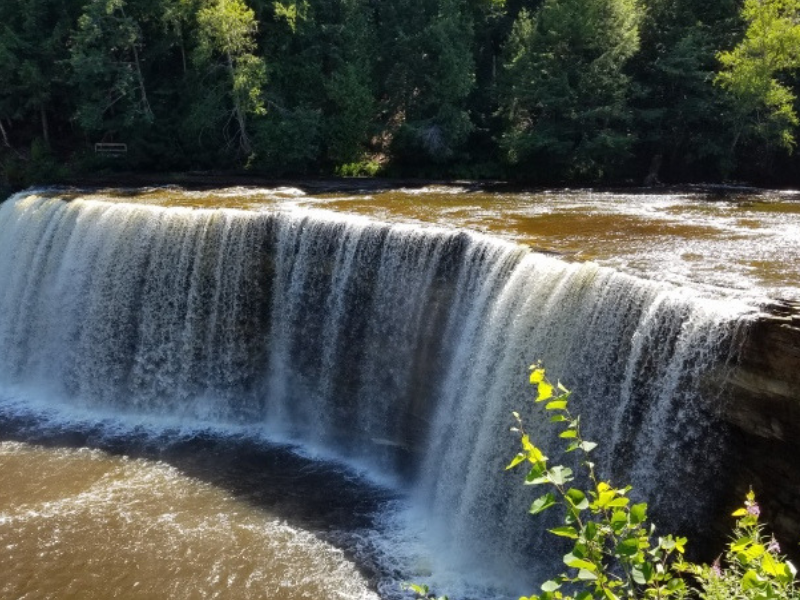 Tahquamenon Falls State Park in Michigan has something for everyone and is open all year round! Photo by April from Minivan Adventures.