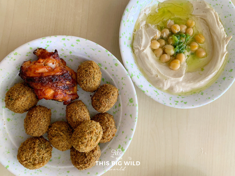 Across the street from Amman's Roman Amphitheater are several restaurants with affordable local cuisine, including hummus and falafel.