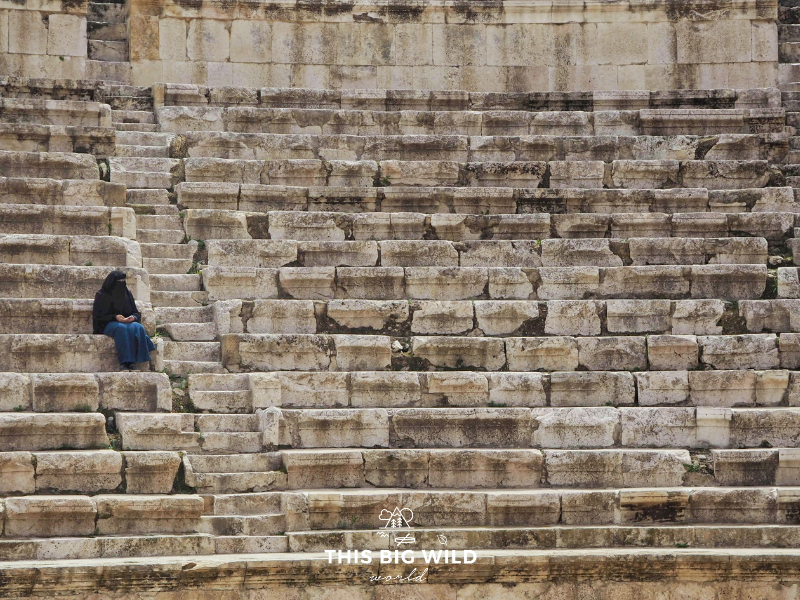 A Muslim woman sits at the Roman Amphitheater in Amman to enjoy the view of the city. The theater was built in around 150AD.