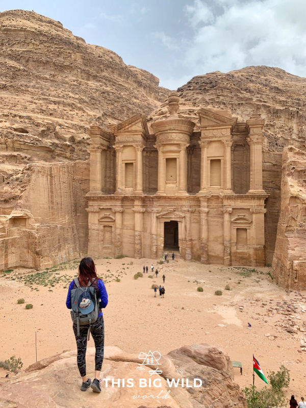 When you visit Petra, wear comfortable shoes and layers to protect you from the wind and sun. Here I'm wearing athletic leggings, sneakers, and a hooded windbreaker while enjoying the view of the Monastery.