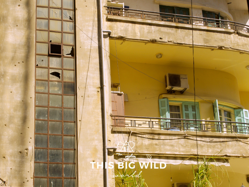 Bullet holes and broken glass in occupied apartment buildings are remnants of past conflict in Beirut.