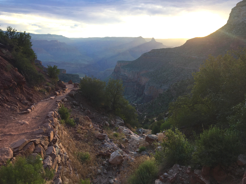 The Bright Angel Trail in the Grand Canyon is beautiful at sunrise as the sun peeks over the edge of the canyon. Photo Credit: The Detour Effect