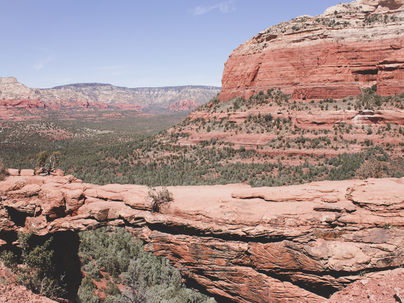 The Devil's Bridge Hike in Sedona Arizona has a moderate risk rating. The view of the red rock formations and green valley behind the bridge are worth it though! Photo Credit : Sights Better Seen
