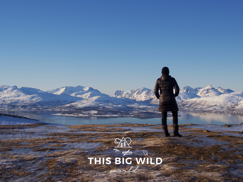 Hike around at the top of the Tromso Fjellheisen cable car for incredible views of snowcapped mountains.