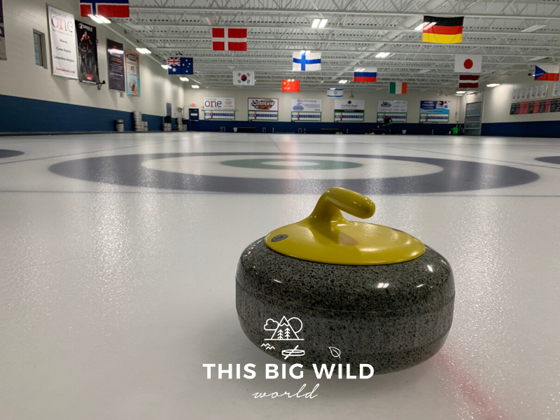A curling stone rests on the ice before the start of a curling match in Minnesota.