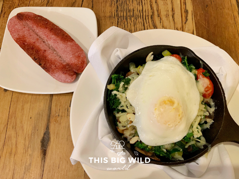 Gluten free kale sausage bake with a fried egg and a side of reindeer sausage from The Red Chair Cafe in Anchorage.