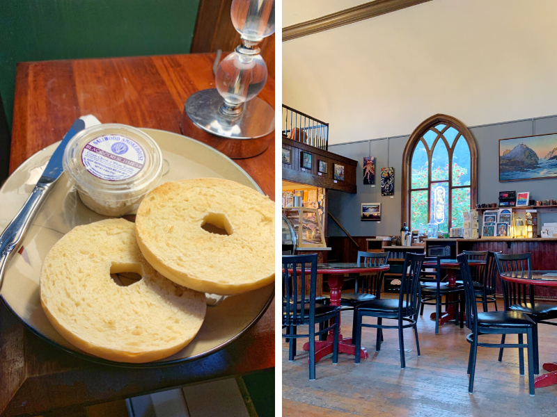 On the left, a plain bagel on a plate with Resurrect Art's delicious black cod shmear. On the right, the interior of Resurrect Art in Seward which is in a repurposed church with arched windows.