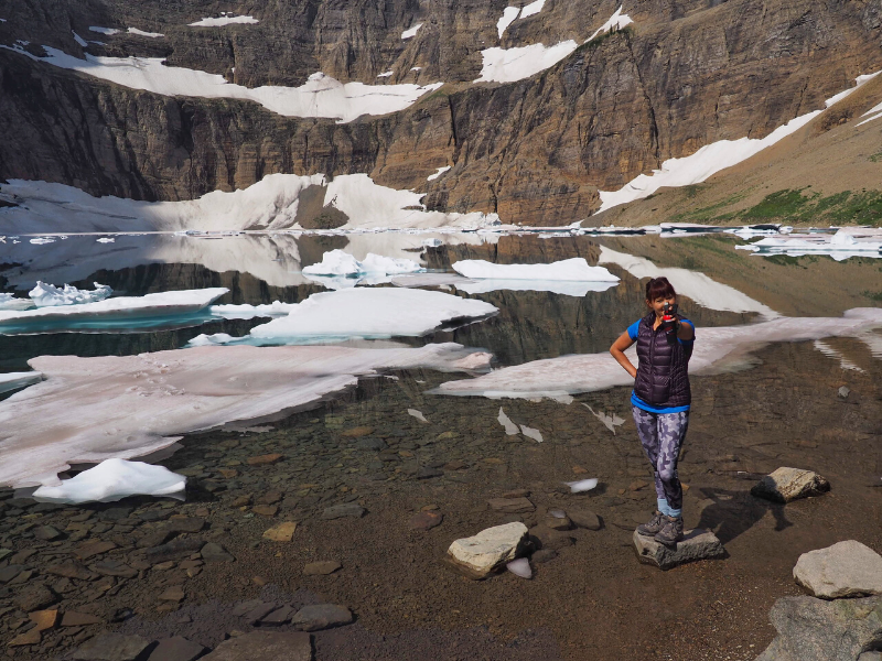 Me standing at Iceberg Lake in Glacier National Park practicing using my bear spray.