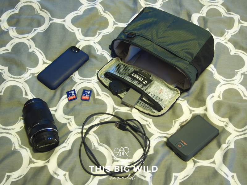 Pack essential camera gear for the Inca Trail, including zoom lens, extended battery pack for your phone, memory cards, extra camera batteries, phone charging cable, power bank, and camera insert.