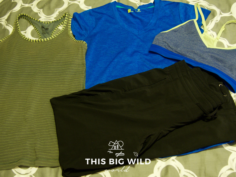 Image of clothing to include on your Inca Trail packing list, including a tank top, a lightweight v-neck t-shirt, and breathable pants.