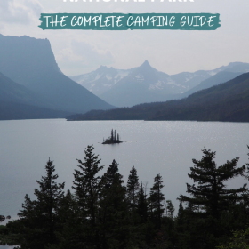 Text: Glacier National Park - the complete camping guide Image: Wild Goose Island is a small island in the middle of a lake surrounded by mountains and forest.