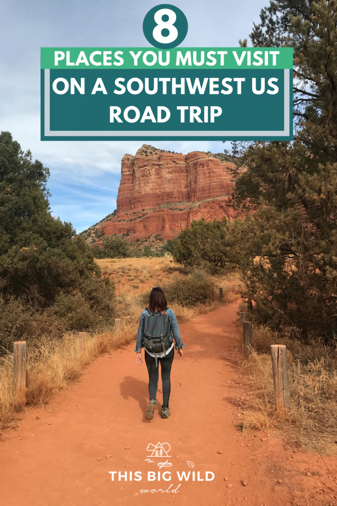 Text: 8 Place You Must Visit on a Southwest US Road Trip. Image: A woman, me, walking in leggings and denim jacket on a red dirt trail with the red rocks of Sedona ahead in the distance. Green brush is on either side of the trail with dry grass.