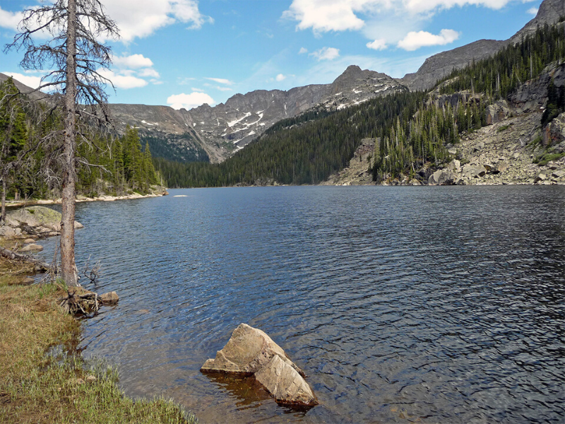 The Lake Verna Trail leads rewards you with a beautiful lake view nestled in the mountains of Rocky Mountain National Park.