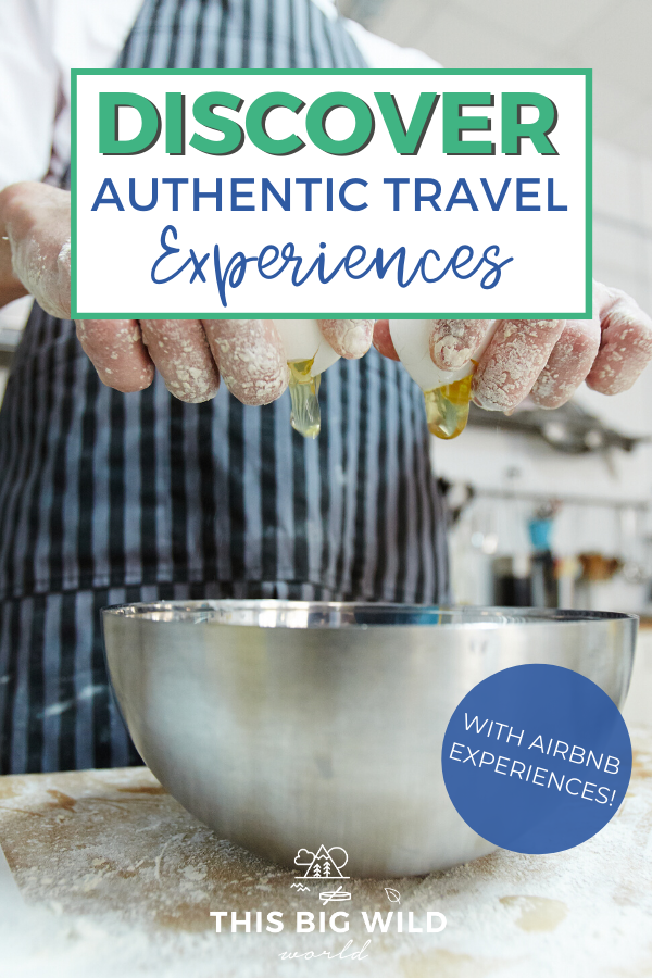 Text: Discover Authentic Travel Experiences - with Airbnb Experiences! Image: Up close shot of a metal bowl on a flour covered wooden surface. Above it is a person in a blue striped apron with their hands cracking an egg into the bowl. A white kitchen is visible in the background.