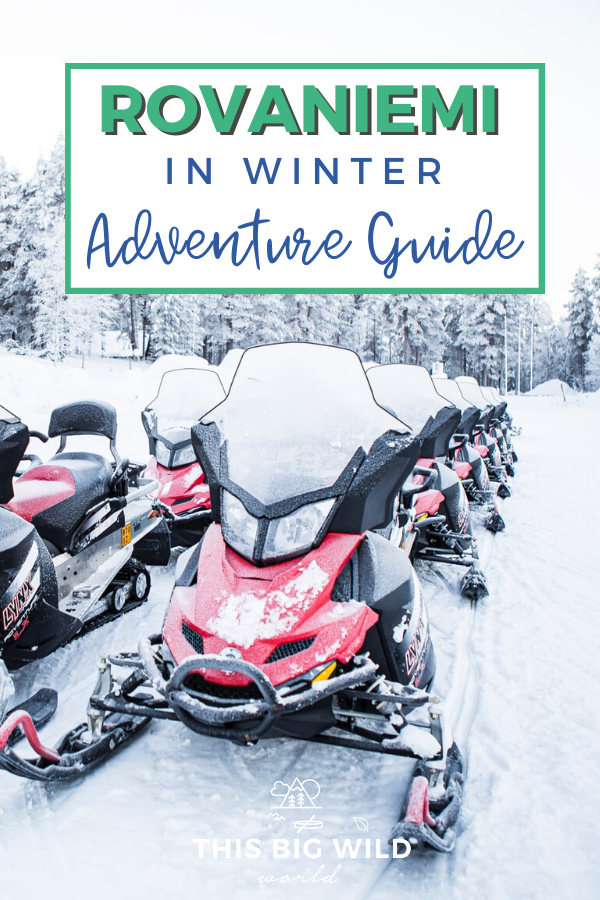Bright red and black snowmobiles perfectly lined up in a snowy arctic forest near Rovaniemi. Text: Rovaniemi in Winter Adventure Guide