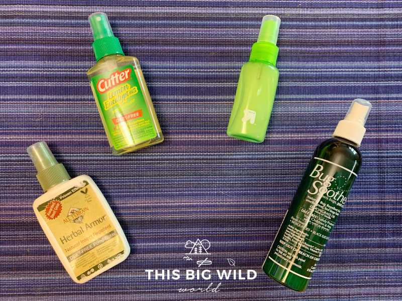 Products to repel mosquitoes while hiking, from left to right: White spray bottle of Herbal Armor Natural Insect repellent, Green and clear spray bottle of Cutter Lemon Eucalyptus DEET-free repellent, a green clear spray bottle of homemade insect repellent, and a dark green tall spray bottle of Bug Soother natural insect repellent.