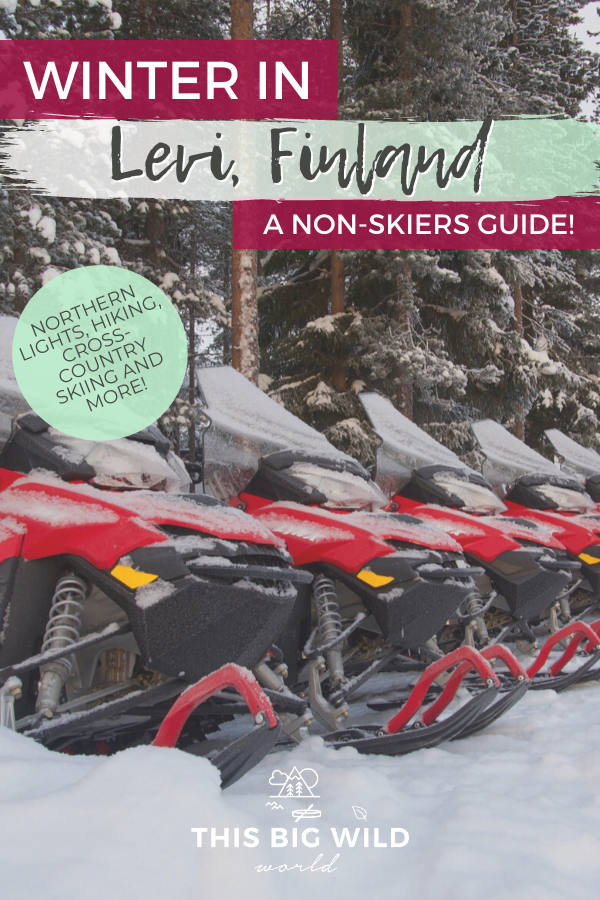 Text: Winter in Levi Finland A Non-Skiers Guide. Also Text in green circle: Northern Lights, hiking, cross-country skiing and more! Background is a line of red snowmobiles resting in front of snow-covered pin trees in Levi Finland.