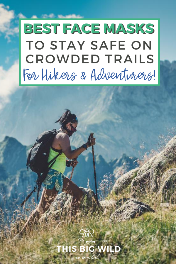 Text: Best Face Masks to Stay Safe on Crowded Trails for Hikers and Adventurers! Image: Woman is hiking in turquoise shorts and a neon yellow top with a backpack, face mask and hiking poles. She's hiking a rocky mountain with mountains and blue sky in the distance behind her.
