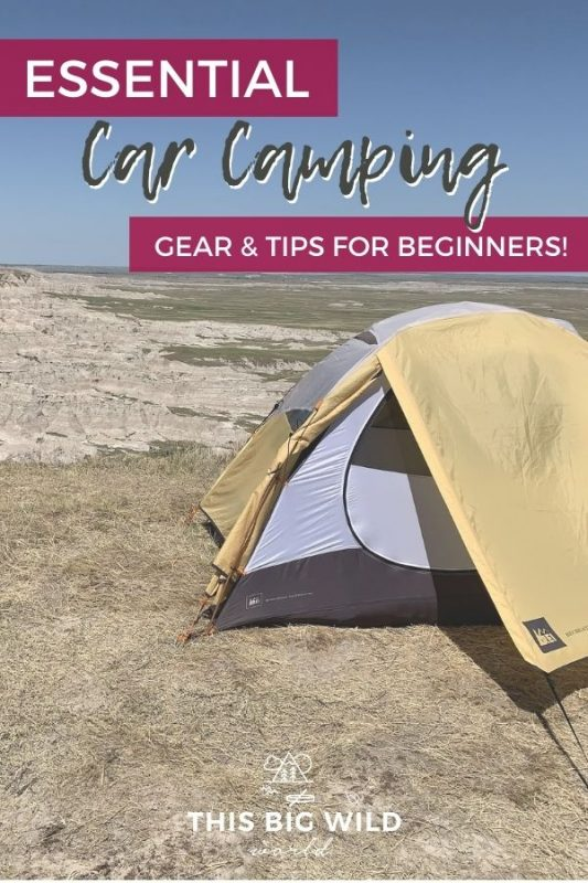 Text: Essential Car Camping Gear & Tips for Beginners! Image: Yellow, white and black tent on brown dry grass overlooking the Badlands below with a blue sky overhead.